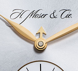 This tiny central arrow indicates the month using the hour indices. Image via H. Moser & Cie.