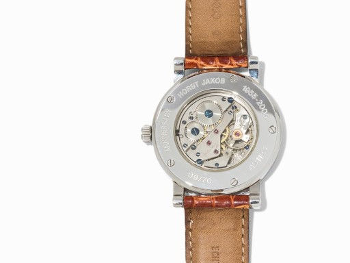 The hand-decorated AS 1123 movement is visible through a sapphire case back, as the limited edition number